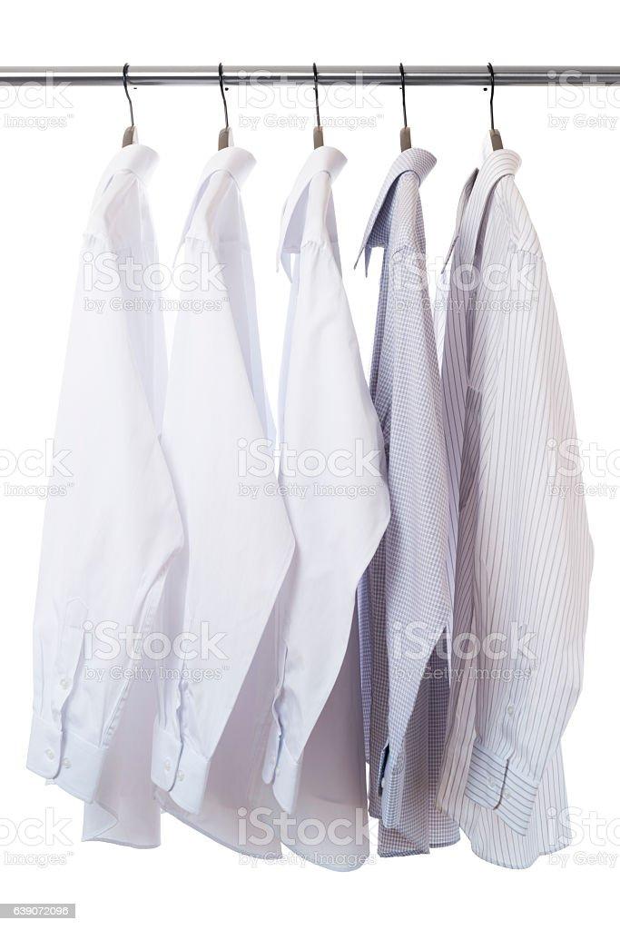 Shirt and hanger hang on a paul stock photo