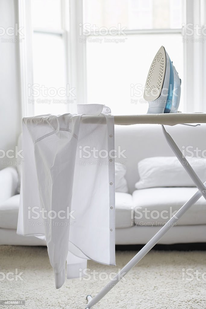 Shirt And Iron On Ironing Board stock photo