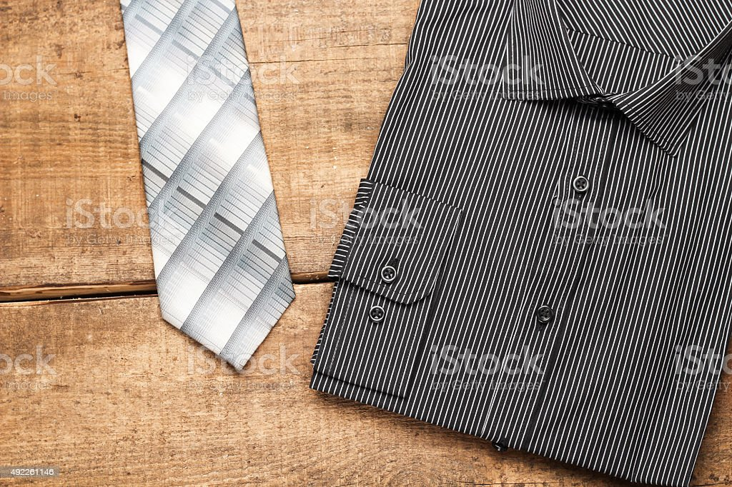 Shirt and tie on a wooden table stock photo