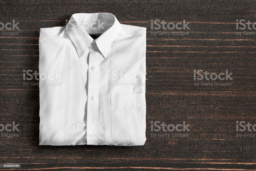 Shirt on wooden background stock photo
