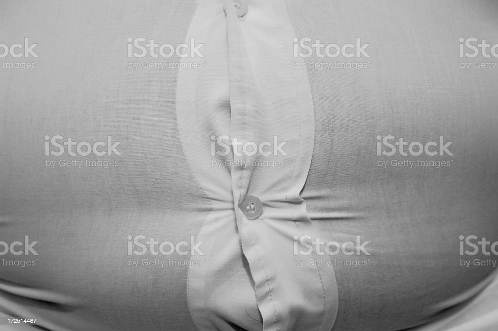 shirt straining over Overweight stomach royalty-free stock photo