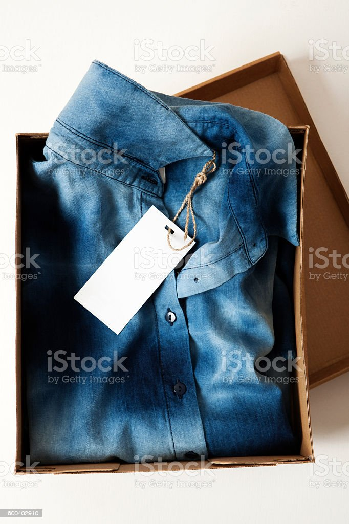 Shirt with price tag stock photo