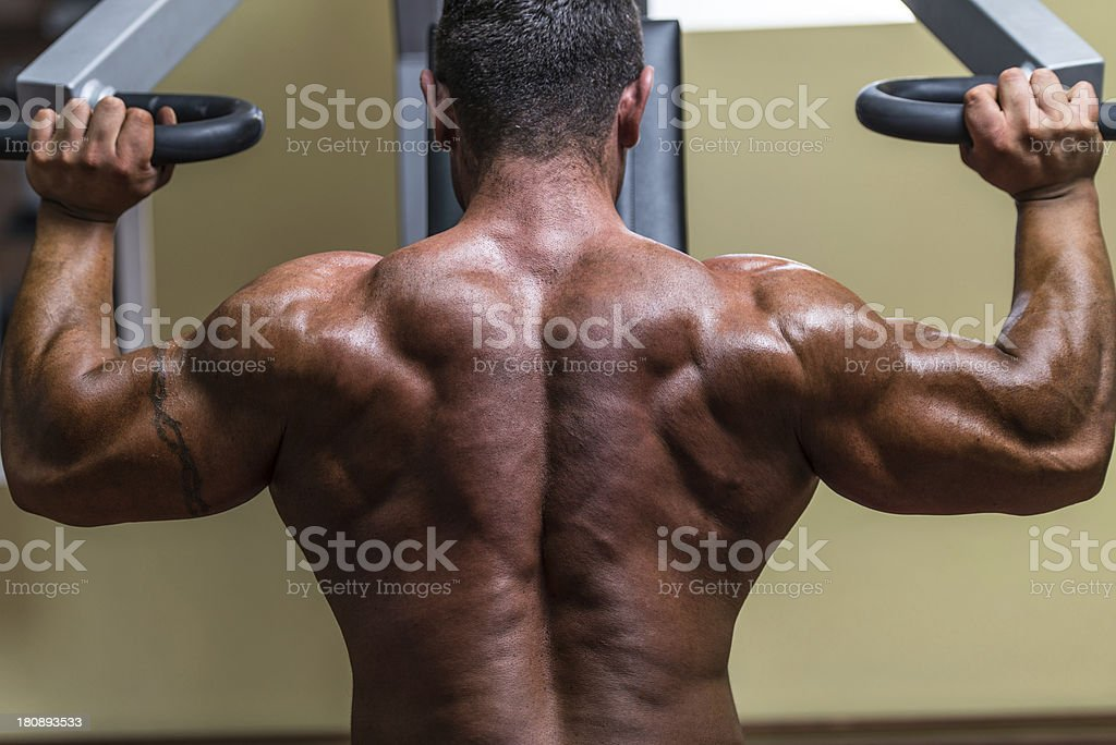 shirtless body builder doing military press for shoulder royalty-free stock photo