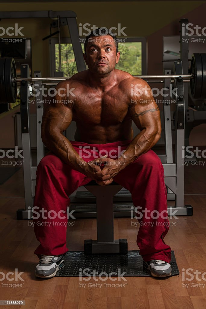 shirtless bodybuilder resting at the bench royalty-free stock photo