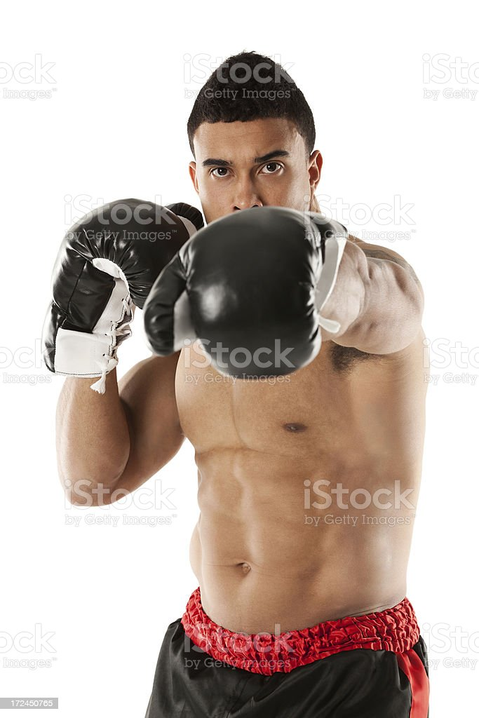 Shirtless boxer punching royalty-free stock photo