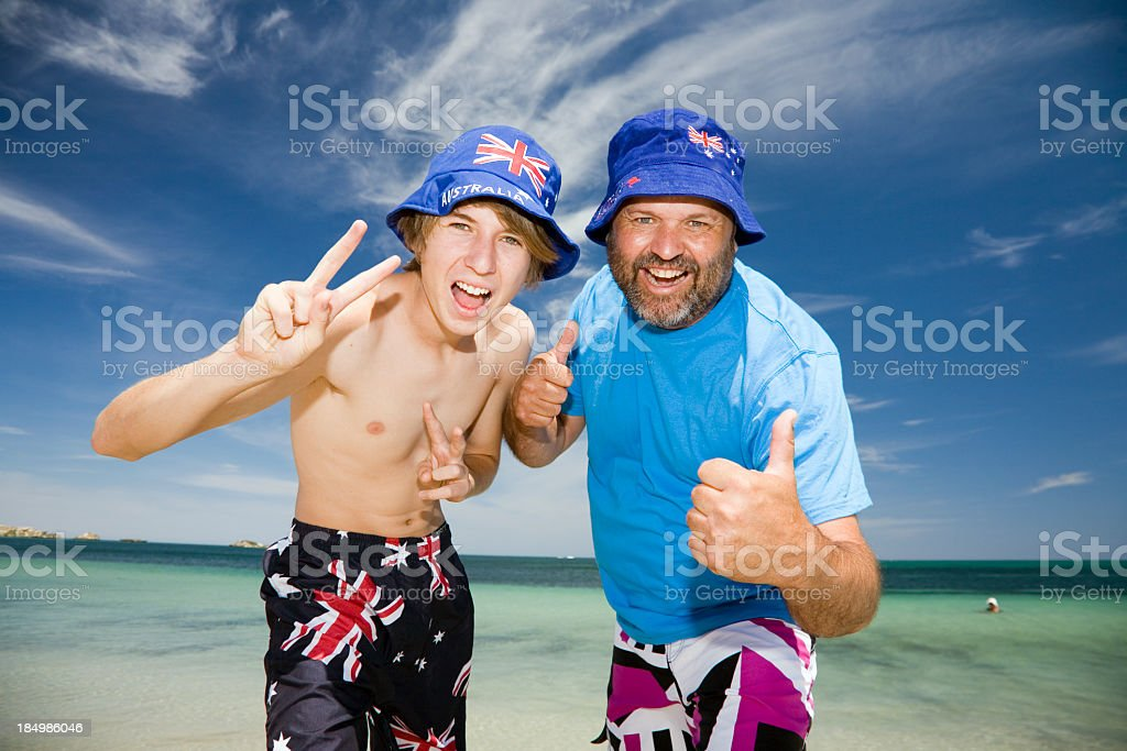 Shirtless boy and older man celebrating Australia Day royalty-free stock photo