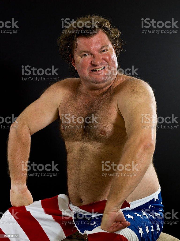 Shirtless Caucasian Mature Man Wearing American Flag royalty-free stock photo