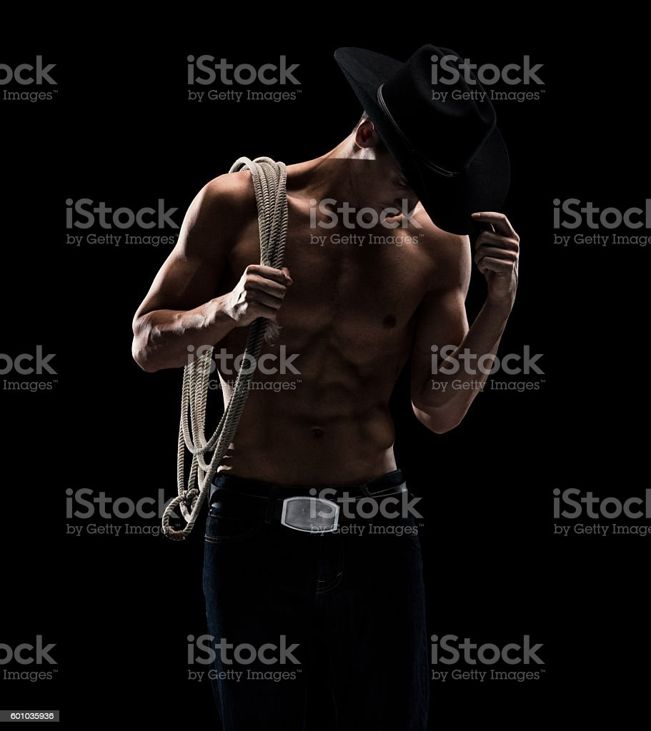 Shirtless cowboy posing stock photo