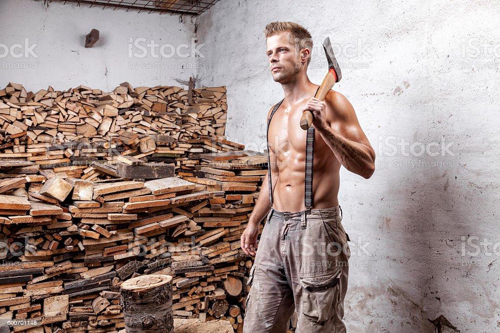 Shirtless lumberjack with an axe stock photo
