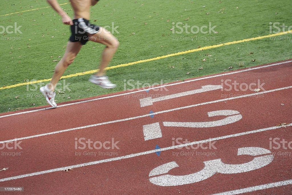 Shirtless Male Athlete Runs on Track royalty-free stock photo