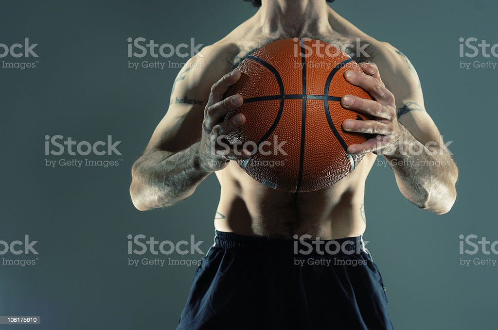 Shirtless Male Basketball Player Holding ball royalty-free stock photo