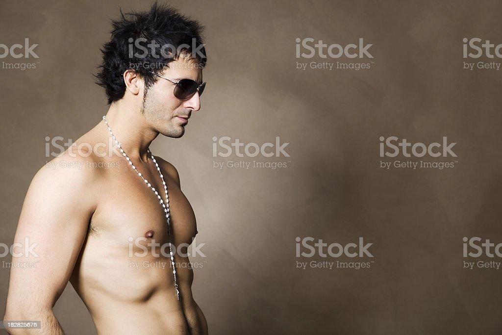 Shirtless Male Model Wearing Sunglasses royalty-free stock photo