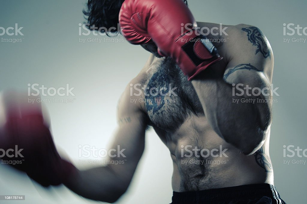 Shirtless Male Wearing Red Boxing Gloves royalty-free stock photo
