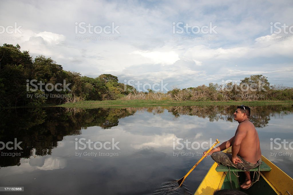 Shirtless man admiring a view of the Amazon River stock photo