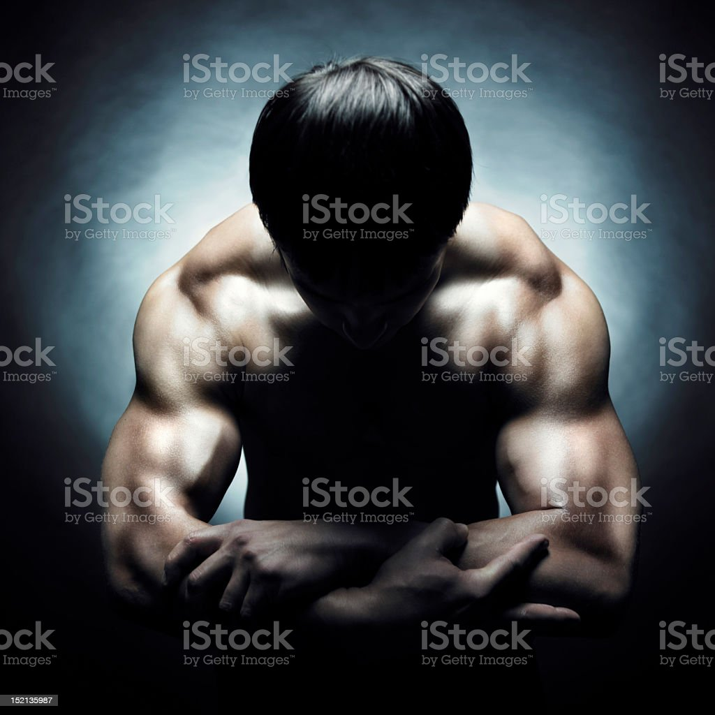 Shirtless man flexing his big muscles royalty-free stock photo