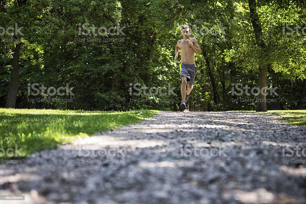 Shirtless Man Jogging Outdoors royalty-free stock photo