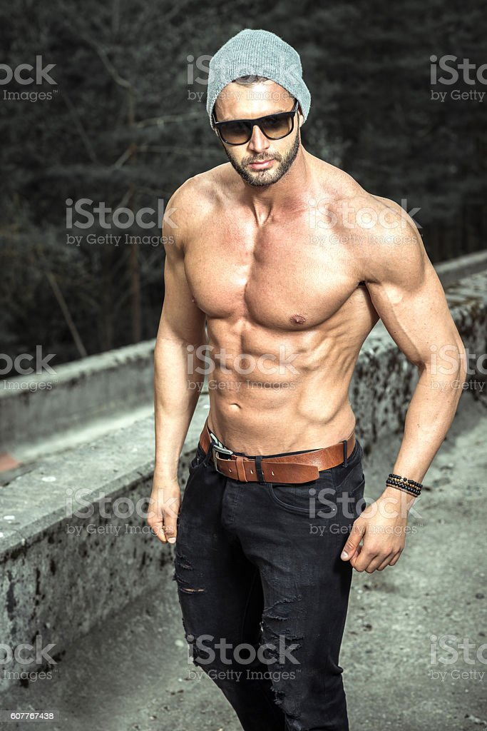 Shirtless man posing outdoor stock photo