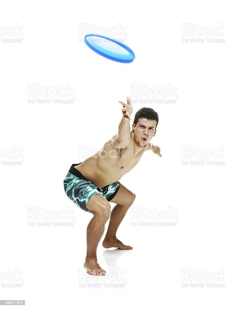 Shirtless man throwing frisbee royalty-free stock photo