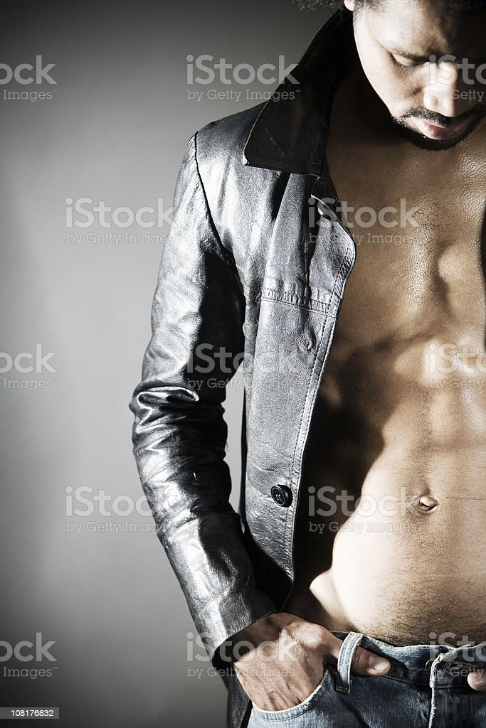 Shirtless Man Wearing Leather Jacket Showing Chest stock photo