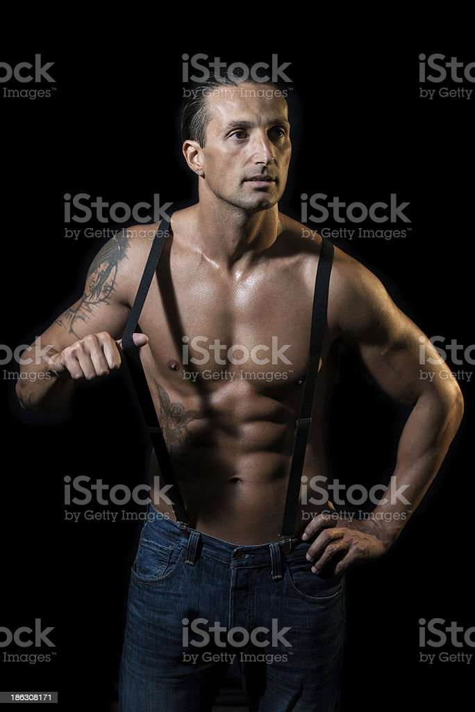 Shirtless Man with Suspenders royalty-free stock photo