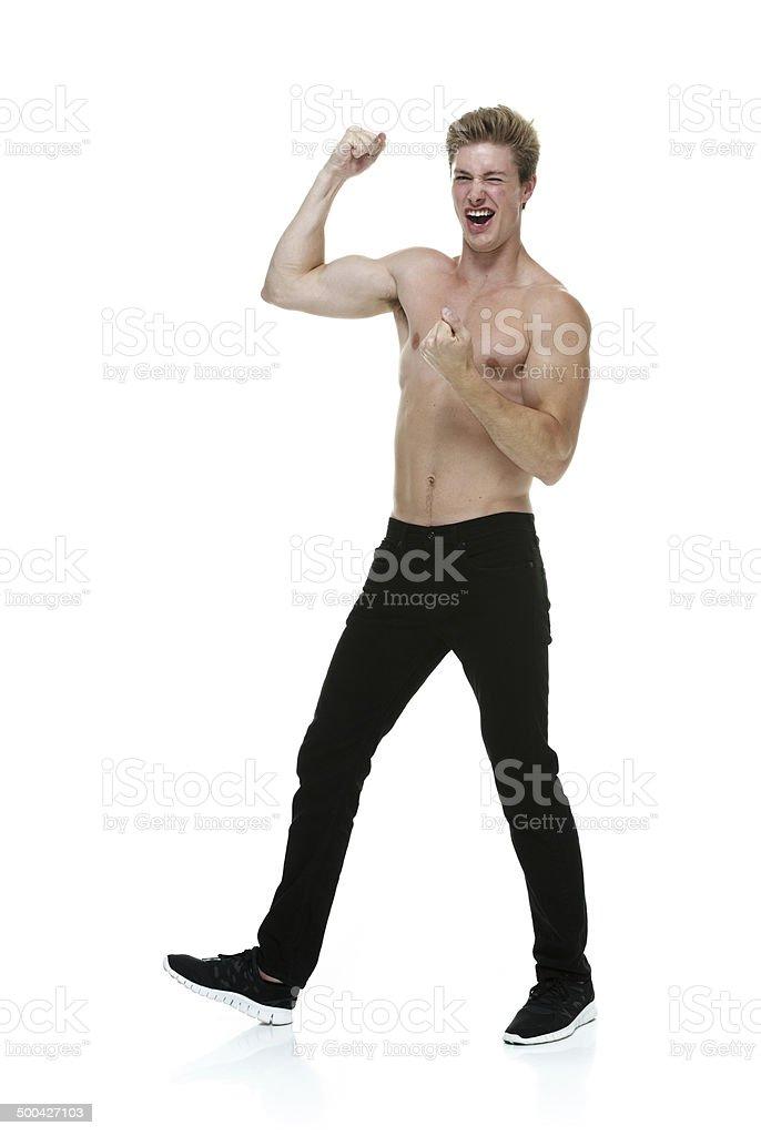 Shirtless muscular man cheering royalty-free stock photo