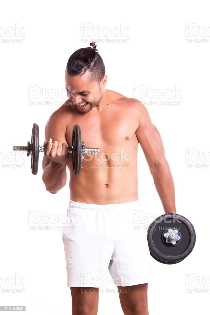 Shirtless muscular man exercising with dumbbell stock photo