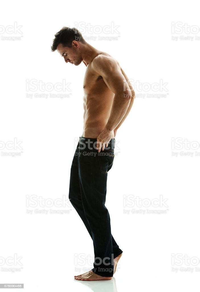 Shirtless muscular man giving a pose stock photo