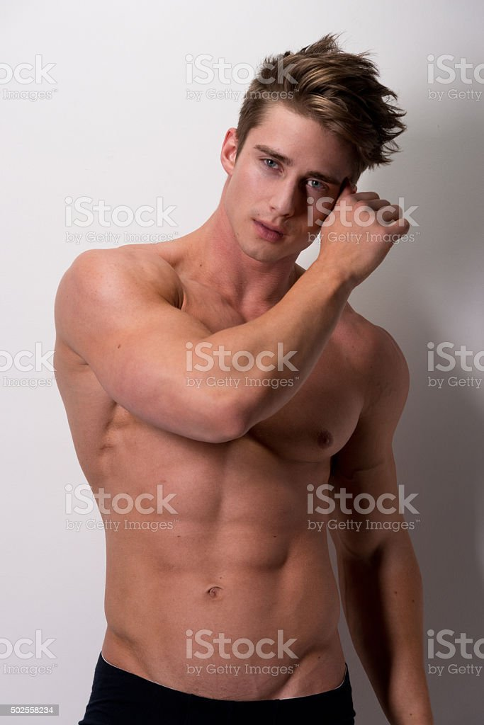 Shirtless muscular man looking at camera stock photo