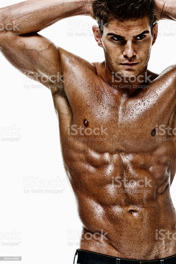 Shirtless muscular man looking away stock photo
