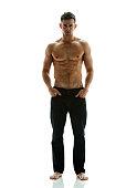 Shirtless muscular man standing
