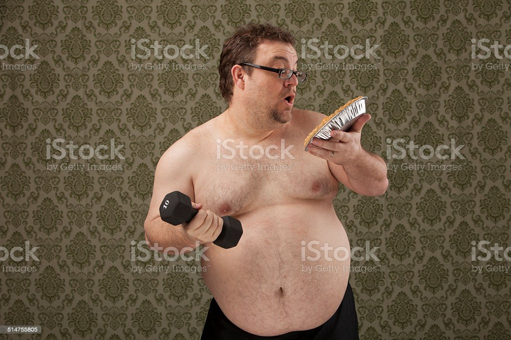 horizontal, color image of an overweight male lifting weights and...