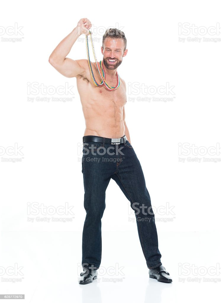 Shirtless smiling muscular man holding necklaces stock photo