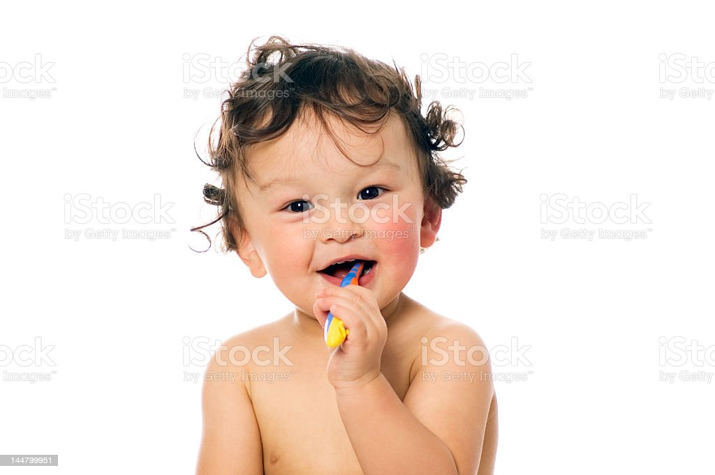 A shirtless toddler smiling and brushing his teeth  royalty-free stock photo