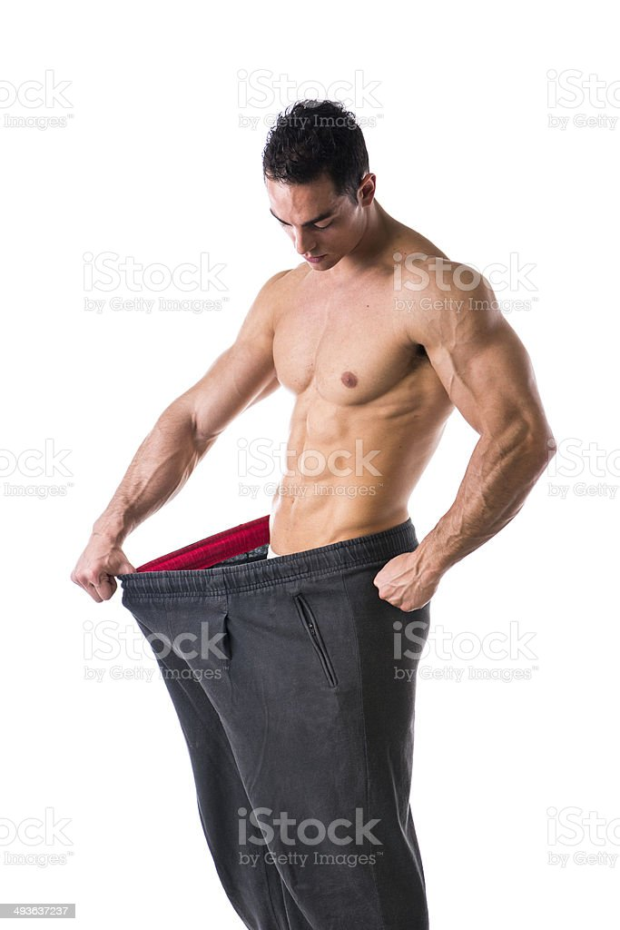 Shirtless young male bodybuilder has lost weight stock photo