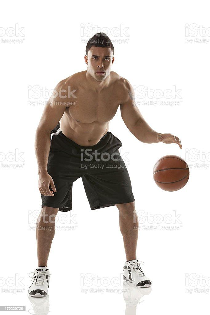 Shirtless young man playing basketball royalty-free stock photo