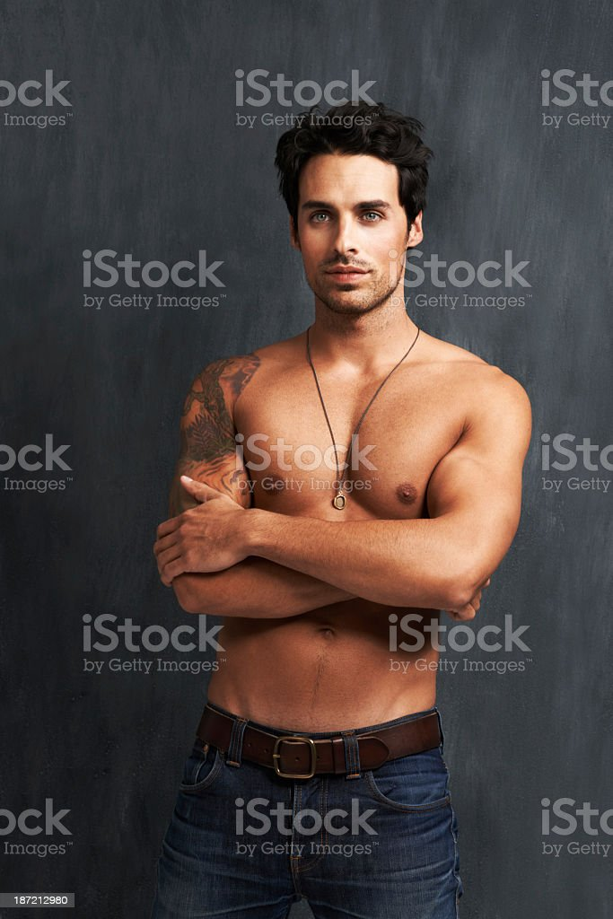 Confident and buff royalty-free stock photo