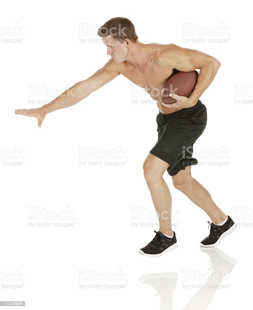 Shirtless young man with a football royalty-free stock photo