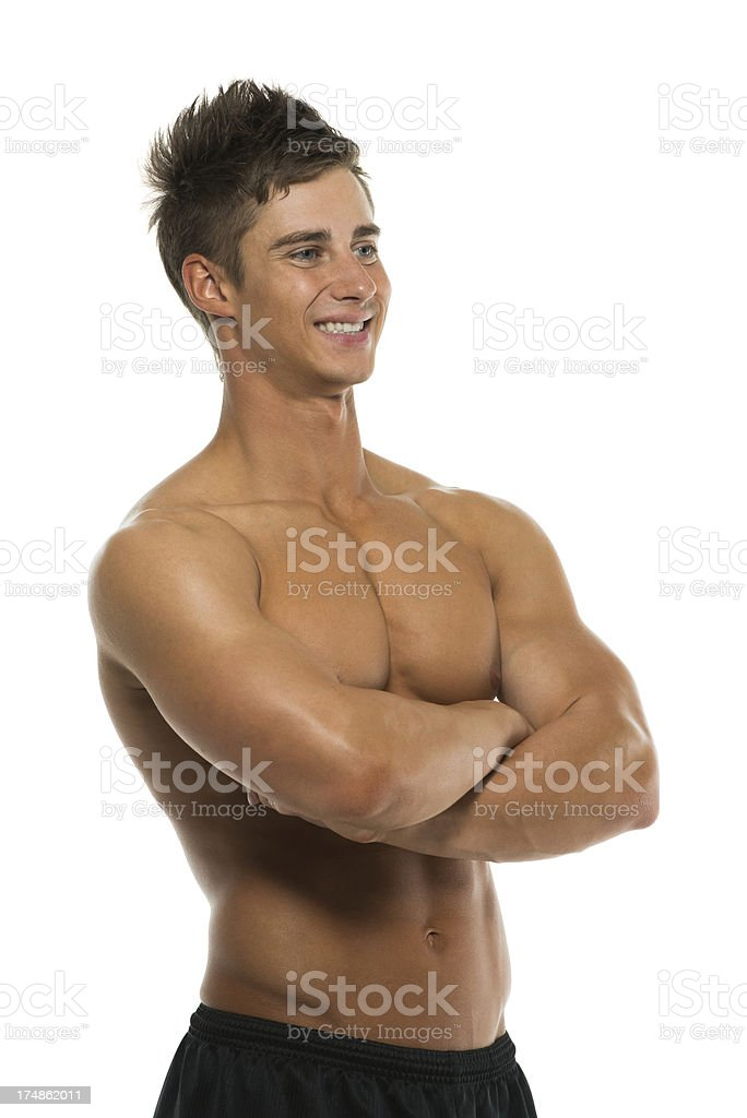 Shirtless young man with arms crossed royalty-free stock photo