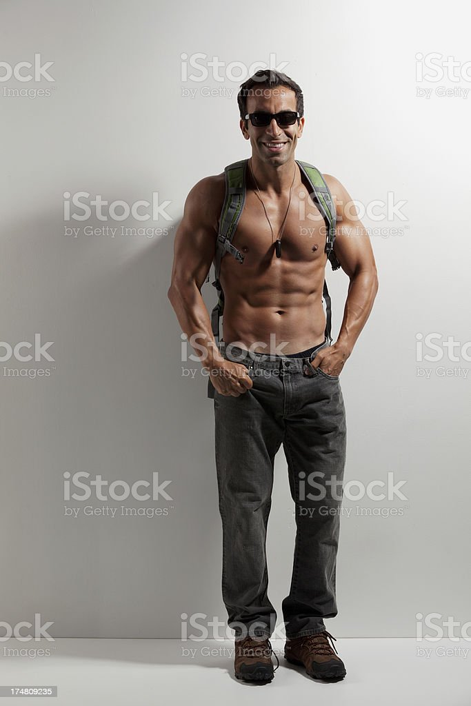 Shirtless young man with hands in pockets royalty-free stock photo