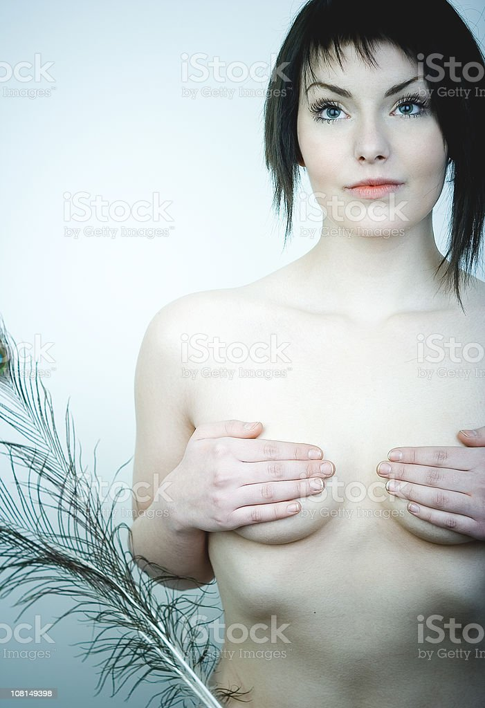 Shirtless Young Woman Holding With Peacock Feather royalty-free stock photo