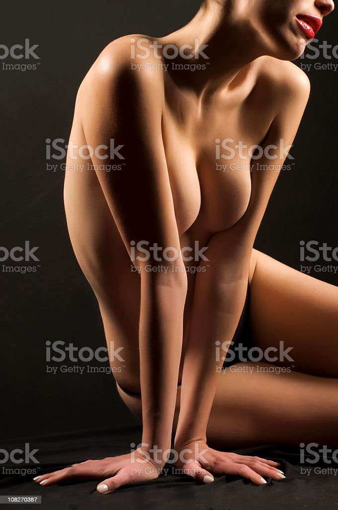 Shirtless Young Woman Sitting and Posing royalty-free stock photo