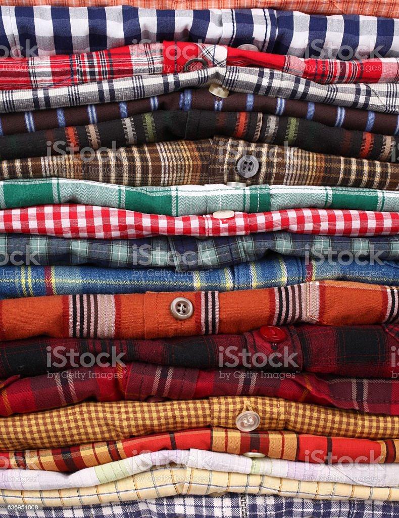 Shirts stack on shelf stock photo