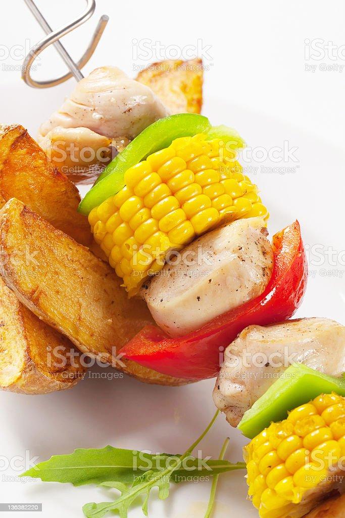 Shish kebab and potato wedges royalty-free stock photo