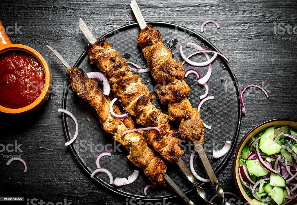 Shish kebab of pork and salad. stock photo