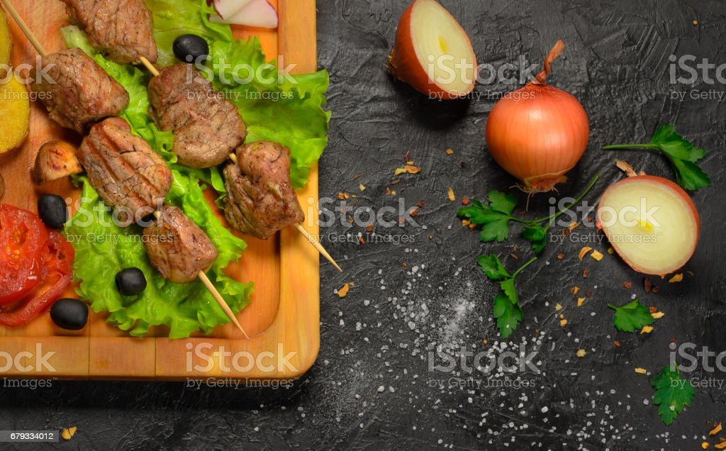 Shish kebab on a dark background stock photo