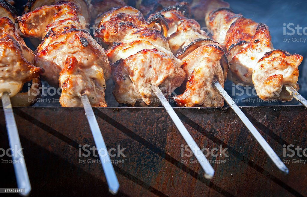 Shish kebab - slices of meat on fire royalty-free stock photo