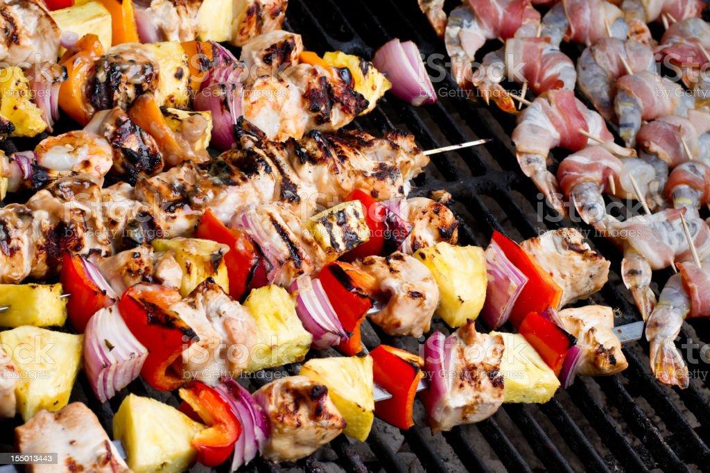 Shish Kebabs and Bacon Wrapped Shrimp stock photo