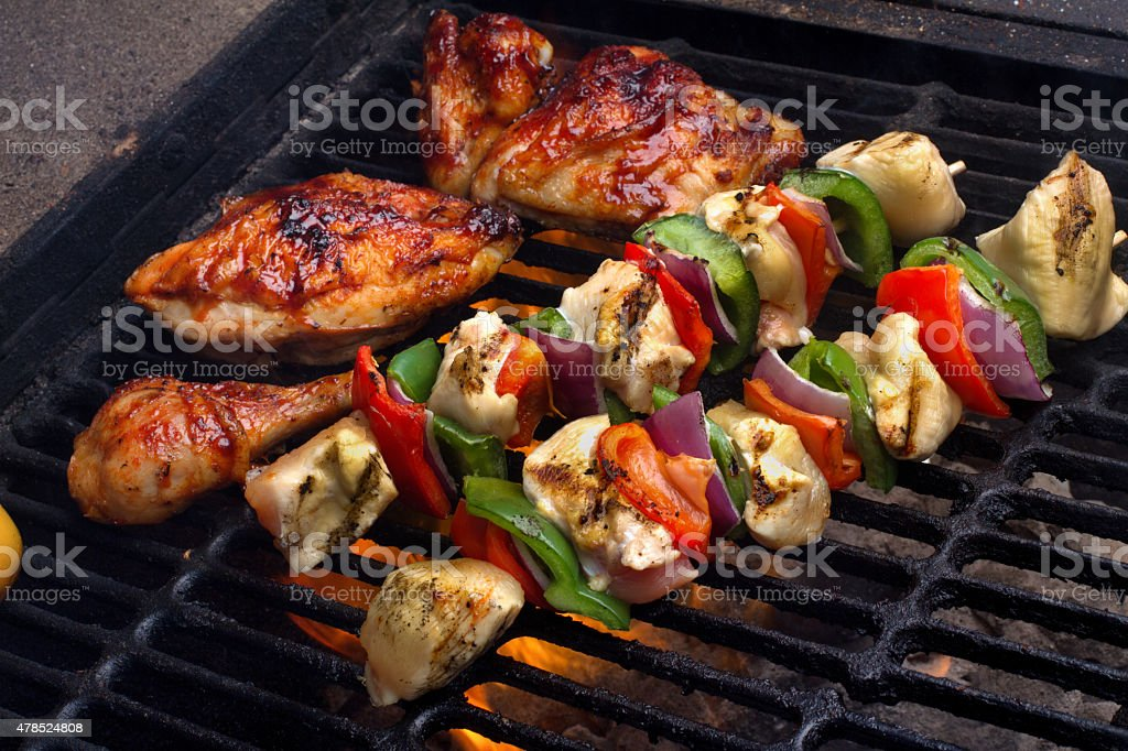 Shish Kebabs on a Flaming Grill with Chicken Breasts stock photo