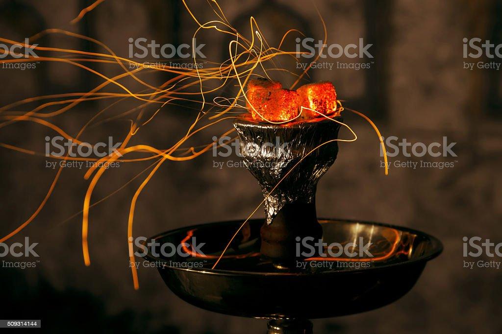 shisha hookah red hot coals. Sparks from breathe stock photo