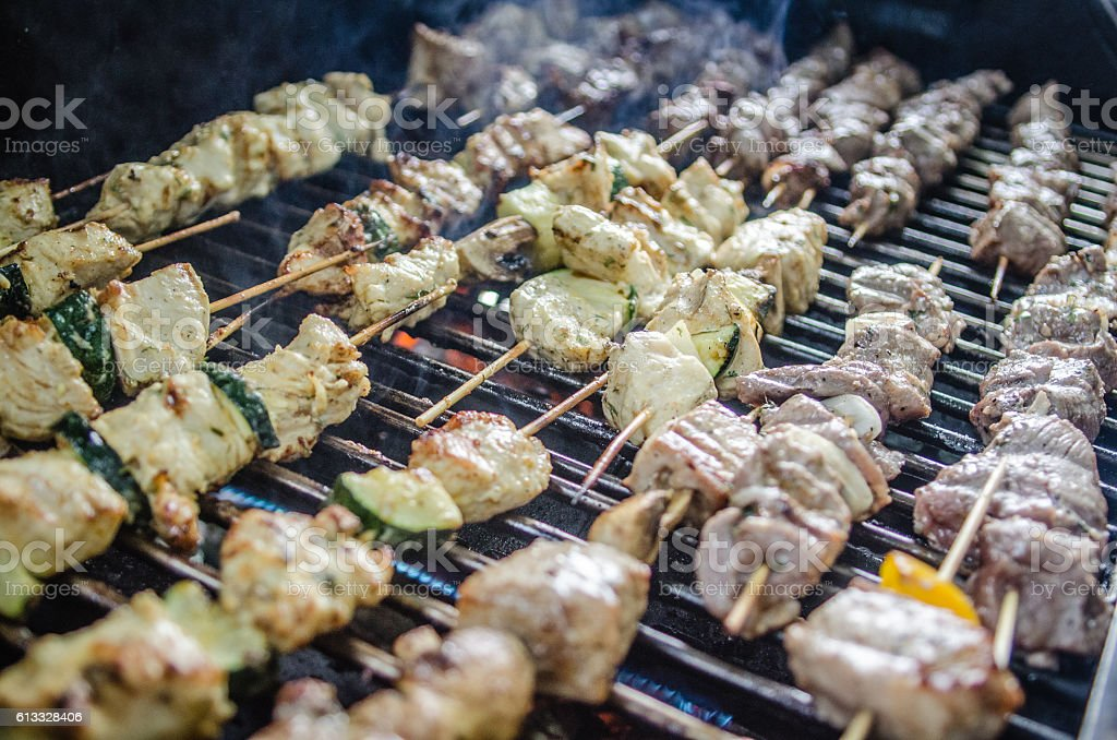 shishkabob being grilled on a grille stock photo